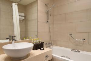 A bathroom at Ramada Downtown Abu Dhabi