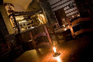 A restaurant or other place to eat at La Taverna del Metallo Rooms