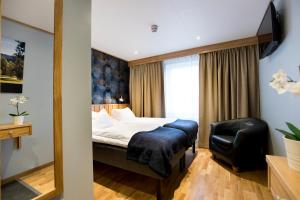 A bed or beds in a room at Lannalodge