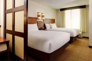 A bed or beds in a room at Hyatt Place Bethlehem-Downtown
