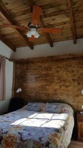 Una cama o camas en una habitación de Septimo Sol