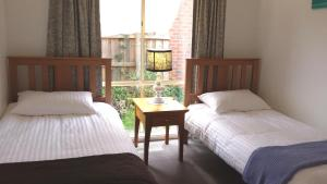A bed or beds in a room at Maroondah 3 Bedroom house in Kilsyth