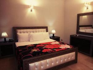 A bed or beds in a room at Royal Galaxy Guest House - For Families Only