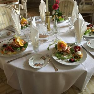 A restaurant or other place to eat at Liselund Ny Slot Hotel