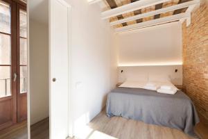 Cama o camas de una habitación en Decô Apartments Barcelona-Born Apt.