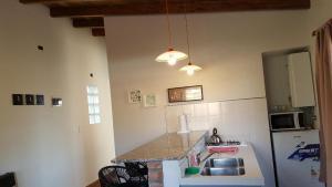 Una cocina o kitchenette en Septimo Sol