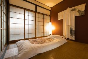 A bed or beds in a room at Yukiya