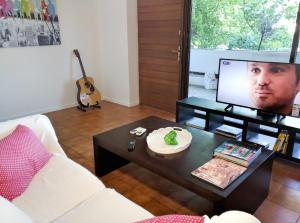 A television and/or entertainment centre at Vivo Apartments