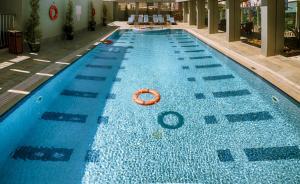 The swimming pool at or near Rose Park Hotel Al Barsha