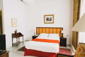 A bed or beds in a room at Ad Hoc Monumental 1881