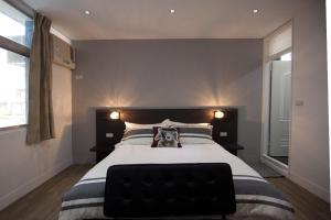 A bed or beds in a room at Chao Daily Rent