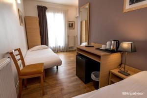 Un pat sau paturi într-o cameră la Hotel de L'Union