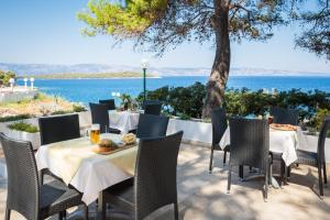 A restaurant or other place to eat at Adriatiq Resort Fontana