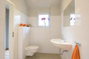 Ein Badezimmer in der Unterkunft AquaMagis Resort