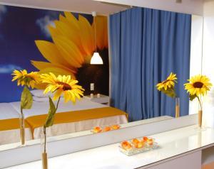 Een bed of bedden in een kamer bij Filoxenia Hotel Tsilivi