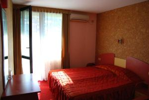 A bed or beds in a room at Korona Hotel