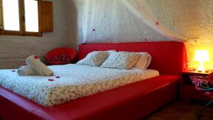 Cama o camas de una habitación en Casas y Cuevas El Solins