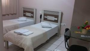 A bed or beds in a room at Inga Palace Hotel