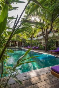 The swimming pool at or near Arjuna Homestay