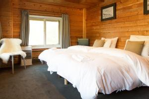 A bed or beds in a room at Moiwa Lodge