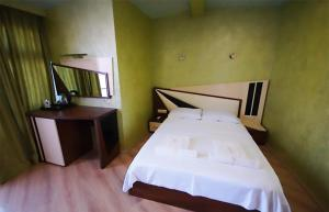 A bed or beds in a room at Black Sea Star Batumi