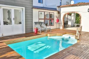 The swimming pool at or near Abington Manor Fish Hoek Guesthouse
