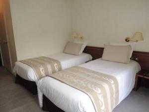 Un ou plusieurs lits dans un hébergement de l'établissement Hotel 4C