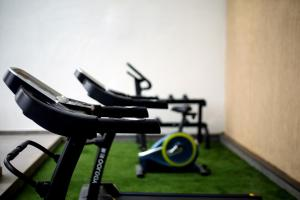 The fitness center and/or fitness facilities at Sidra Pristine Hotel and Portico Halls