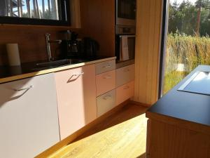 A kitchen or kitchenette at Marina Holiday Lotus Village