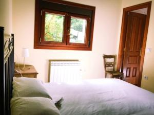 A bed or beds in a room at Casa Rural Sanabria