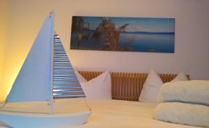 Ein Bett oder Betten in einem Zimmer der Unterkunft Ferienwohnung Markt 7