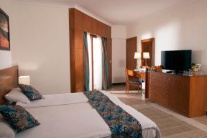 מיטה או מיטות בחדר ב-Swiss Inn Resort Dahab