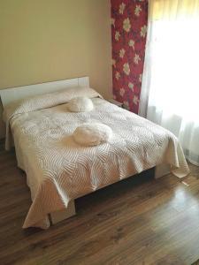 Lova arba lovos apgyvendinimo įstaigoje Kaimo Turizmo Sodyba Margiškių Dvaras
