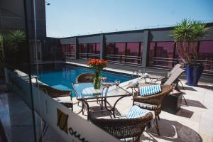 The swimming pool at or near Noumi Plaza Hotel