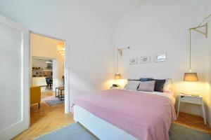 A bed or beds in a room at Hygge Apartment