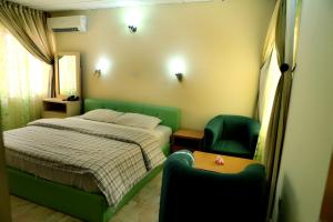 A bed or beds in a room at Nspri Guest Houses