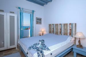 A bed or beds in a room at Villa Veni