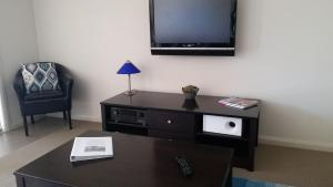 A television and/or entertainment center at Cypress waterfront spa apartment