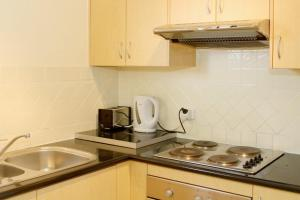 A kitchen or kitchenette at Bay Village Unit 20, 47 Shoal Bay Road