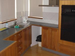 A kitchen or kitchenette at Edgewater, 3/145 Shoal Bay Road