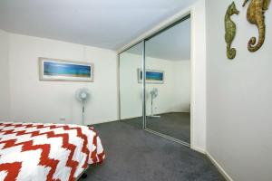 A bed or beds in a room at Horizons Golf Club, Villa 107