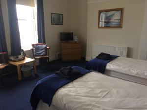A bed or beds in a room at Royal Temple Yacht Club