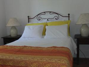 A bed or beds in a room at Casa d'Avó