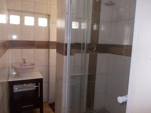 A bathroom at All Are Welcome Guest House