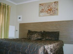 A bed or beds in a room at All Are Welcome Guest House