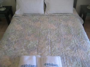 Ένα ή περισσότερα κρεβάτια σε δωμάτιο στο Kyveli Hotel Apartments