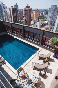 A view of the pool at Noumi Plaza Hotel or nearby