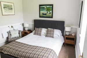 A bed or beds in a room at Llety Brynawel Guest House