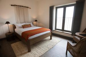 A bed or beds in a room at The Farmhouse at Meletos