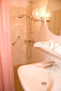 Een badkamer bij Hotel Excelsior